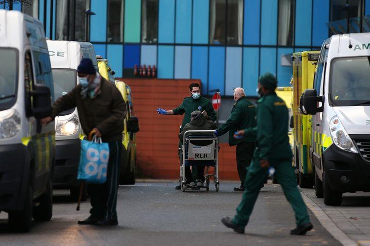 Paramedics wheel a patient into The Royal London Hospital.