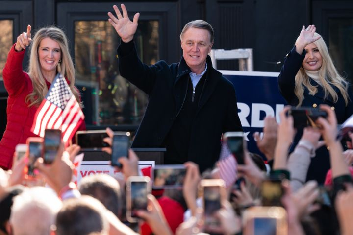 Georgia Sens. Kelly Loeffler (left) and David Perdue (center) campaign with Ivanka Trump on Dec. 21. They have painted the el