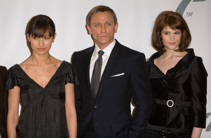 """Olga Kurylenko (left), Daniel Craig and Gemma Arterton pictured together promoting """"Quantum of Solace"""" in 2008."""