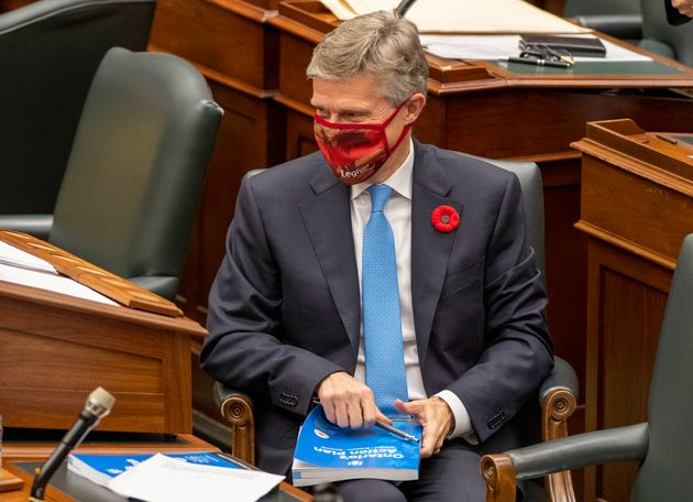 Ontario Finance Minister Rod Phillips autographs copies of the Provincial Budget for MPPs in the Ontario...