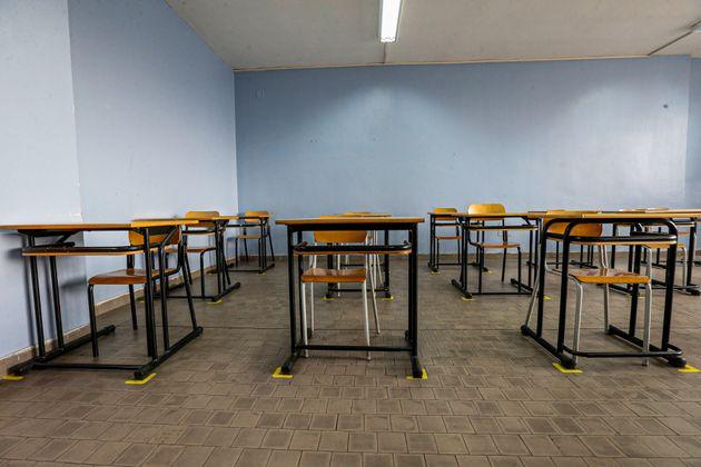 NAPLES, CAMPANIA, ITALY - 2020/12/17: An empty school classroom with desks spaced 1 metre apart, ready...