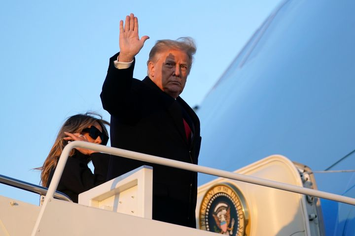 President Donald Trump waves as he boards Air Force One at Andrews Air Force Base, Md., Wednesday, Dec. 23, 2020. (AP Photo/P