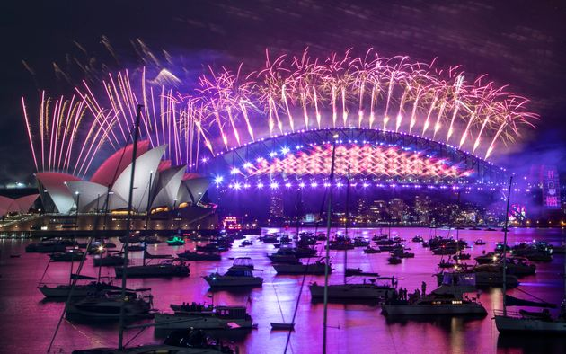 Fireworks explode over the Sydney Opera House and Harbour Bridge as New Year celebrations begin in Sydney,...