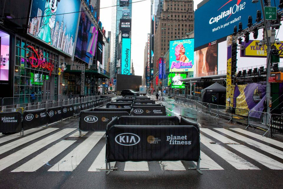 Barricades are set up to keep social distance before the New Year's Eve celebration in Times Square,...
