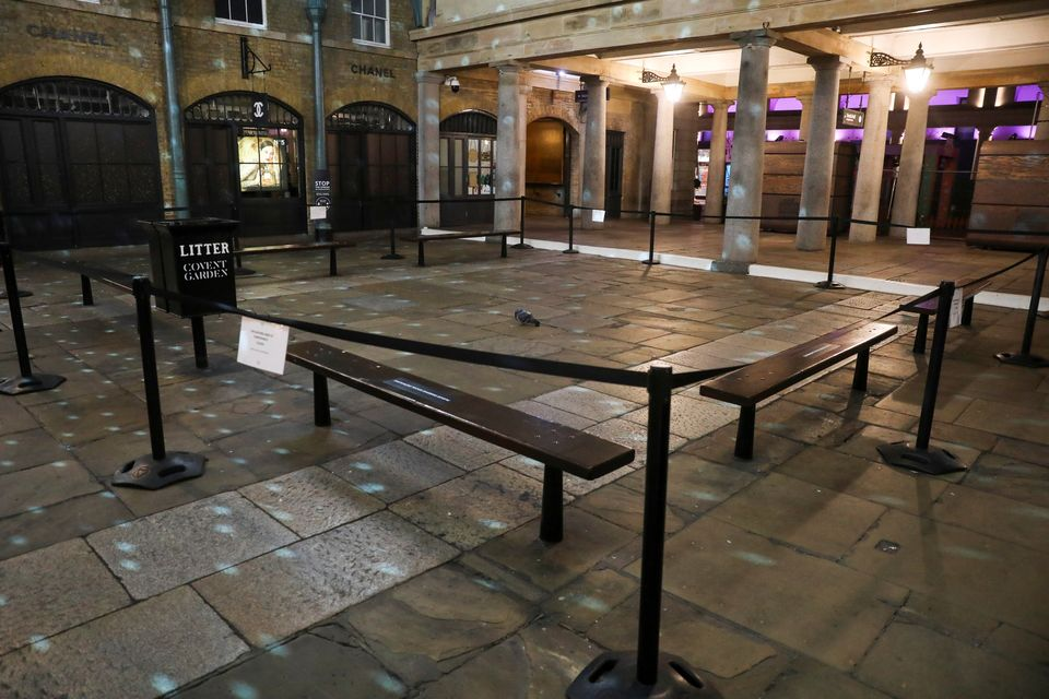 A pigeon sits in a square in Covent Garden during the New Year's Eve amid the coronavirus disease outbreak...