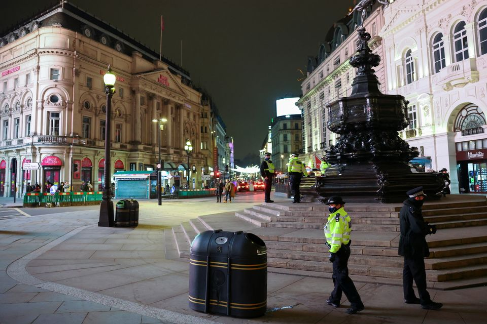 Police officers are pictured at Piccadilly Circus during New Year's