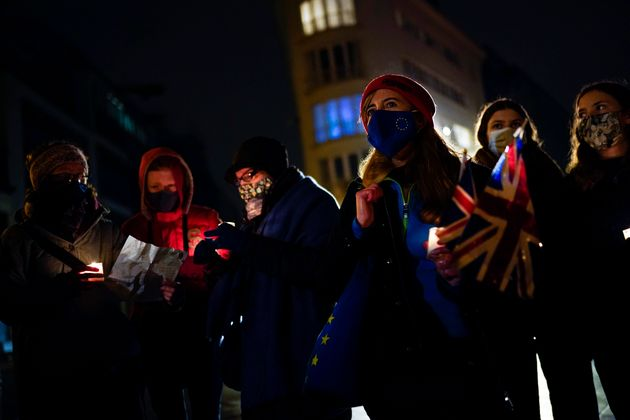 British citizens, who live in Belgium, hold candles and Union flags during an anti Brexit vigil in front...