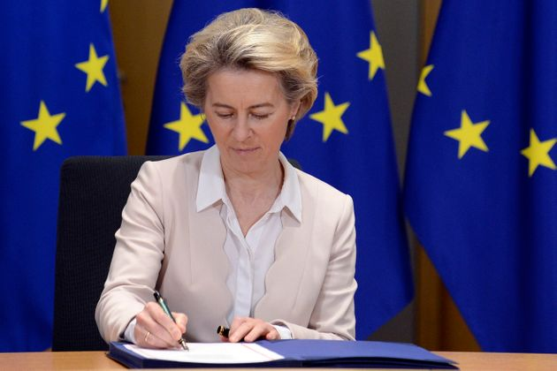 European Commission President Ursula von der Leyen signs the EU-UK Trade and Cooperation Agreement at...