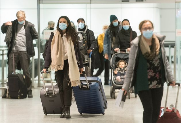 Passengers are shown in the international arrivals hall at Montreal-Trudeau Airport in Montreal on