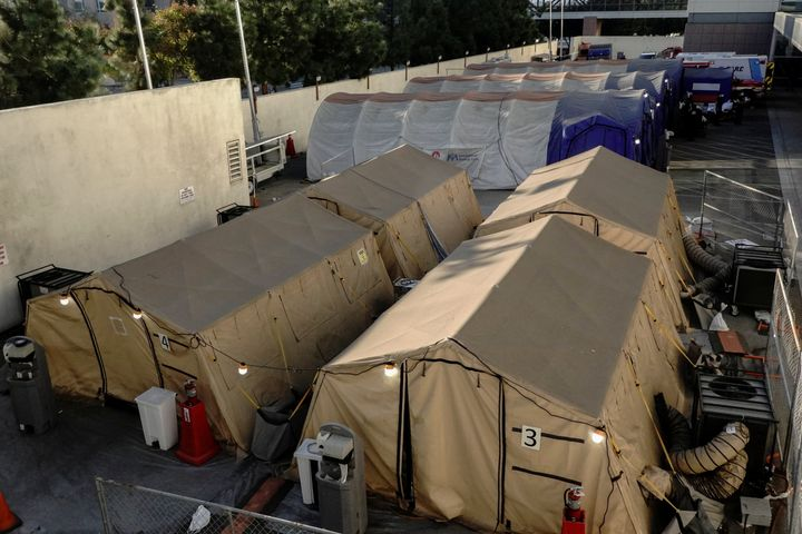 Triage tents for treating COVID-19 patients are seen outside LAC + USC Medical Center this past weekend.