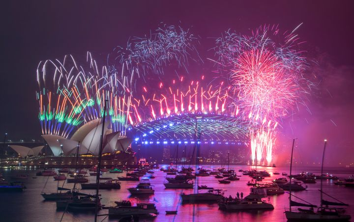 Fireworks explode over the Sydney Opera House and Harbour Bridge as New Year celebrations begin in Sydney, Australia, Friday,