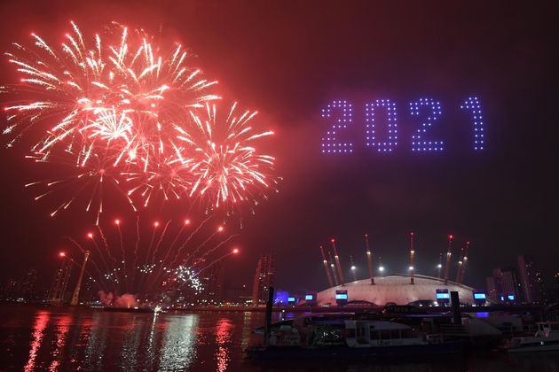 Fireworks and drones illuminate the night sky over the The O2 in London as they form a light display...