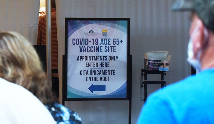 People enter a COVID-19 vaccination site for seniors on New Years Eve in Oviedo, Florida. Governor Ron DeSantis ordered that