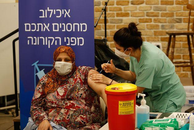 TEL AVIV, ISRAEL - DECEMBER 31: A medical worker injects Pfizer-BioNTech's coronavirus (COVID-19) vaccine...