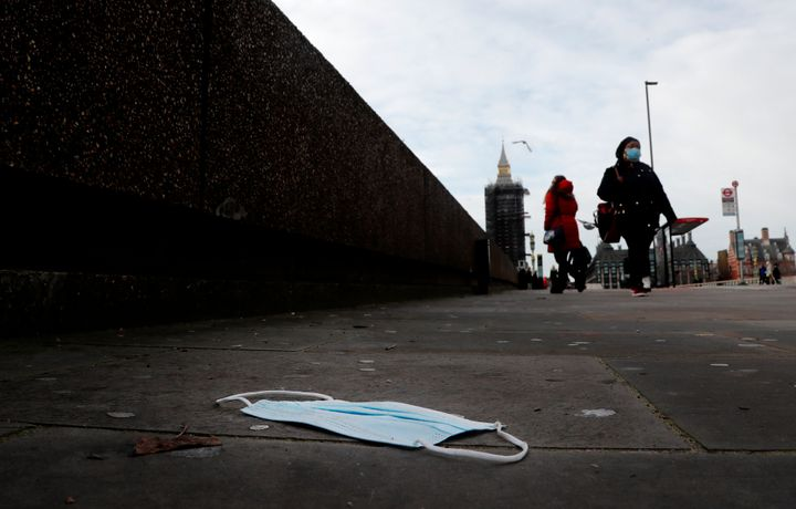 A mask on the pavement near the entrance of a hospital on Westminster Bridge in London, Wednesday, Dec. 30, 2020.