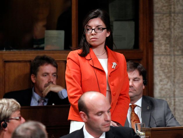 New Democratic Party Member of Parliament Niki Ashton stands to vote in the House of Commons on Parliament...