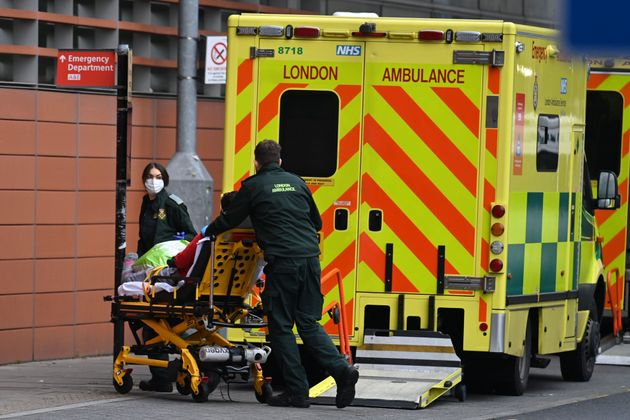 London Ambulance staff stretcher a patient from the ambulance into The Royal London Hospital in east