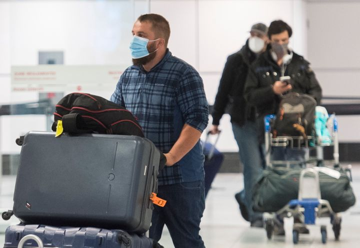 Passengers are shown in the international arrivals hall at Trudeau Airport in Montreal on Dec. 29, 2020.