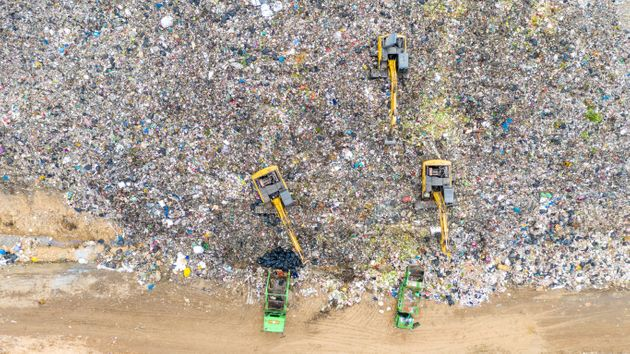 Aerial shot top view Garbage trucks unload garbage to a recycle in the vicinity of the city of Bangkok,