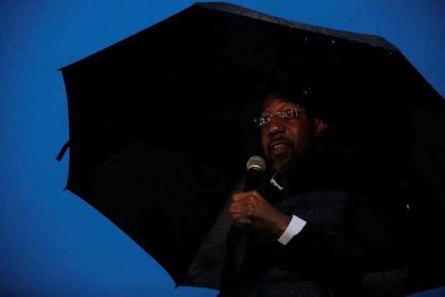 Democratic candidate for the U.S Senate Rev. Raphael Warnock speaks at a drive-in campaign rally in the...