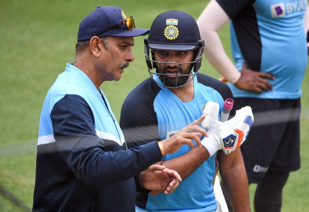 India's Rohit Sharma (R) chats with team coach Ravi Shastri (L) during a training session at the MCG in Melbourne on January 2, 2021, ahead of the third cricket Test match in Sydney on January 7.