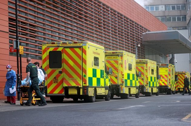 Medics transport a patient from an ambulance to the Royal London Hospital on January
