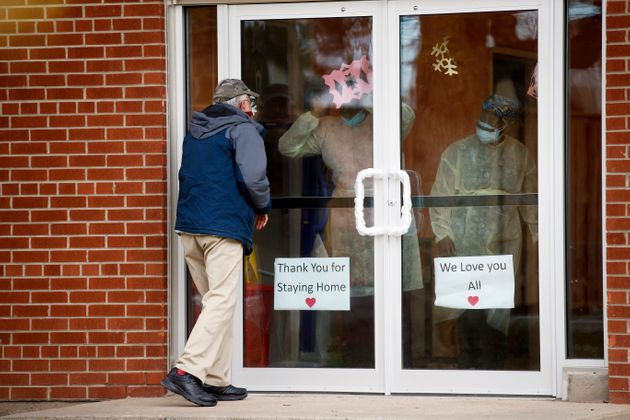 A man attempts to visit a family member at a long-term care home in Toronto on May 10, 2020. Provincial...