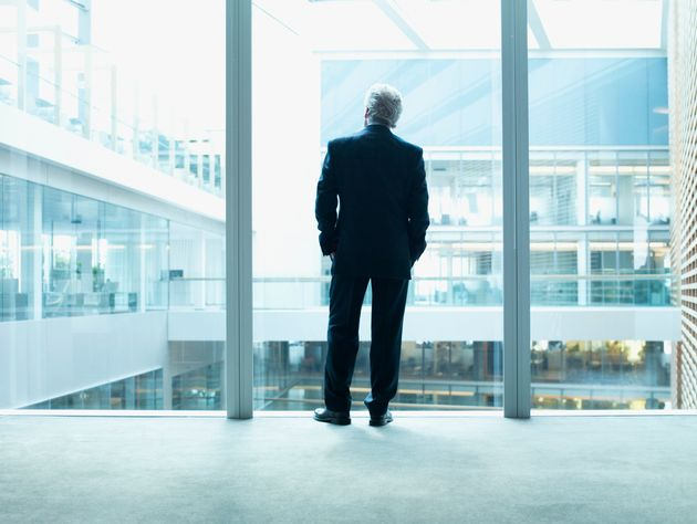 A top executive looks outside of a window in this stock photo. A new report says the average pay of a...