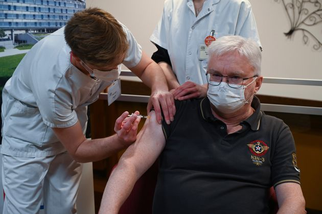 Professor of geriatrics Pierre Jouanny receives a dose of the Pfizer-BioNTech Covid-19 vaccine at the...