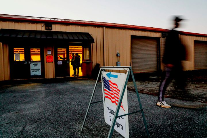 Voters enter and exit a polling station at the Gwinnett County Fairgrounds on January 5, 2021 in Lawrenceville, Georgia. (Pho