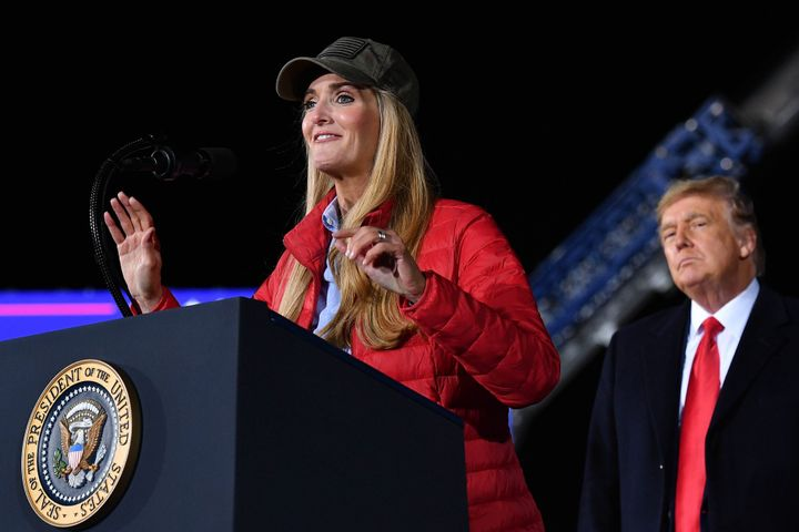 Republican incumbent senator Kelly Loeffler speaks as President Donald Trump listens during a rally in support of Republican