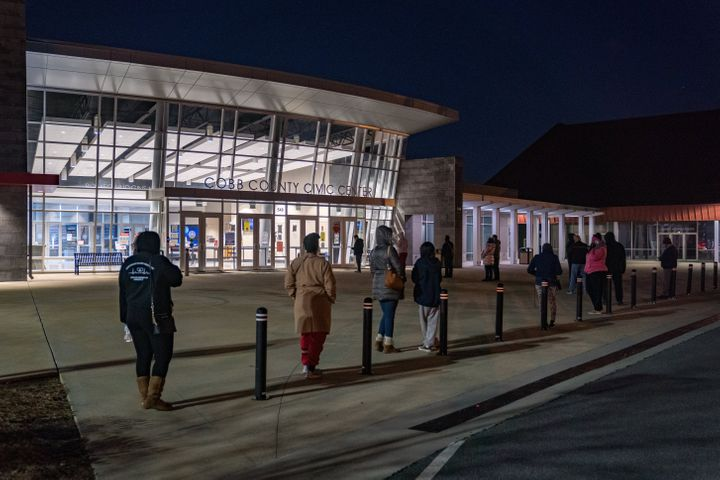 Voters stand in line before the doors open at Cobb County Community Center on January 5, 2021 in Atlanta, Georgia. (Photo by