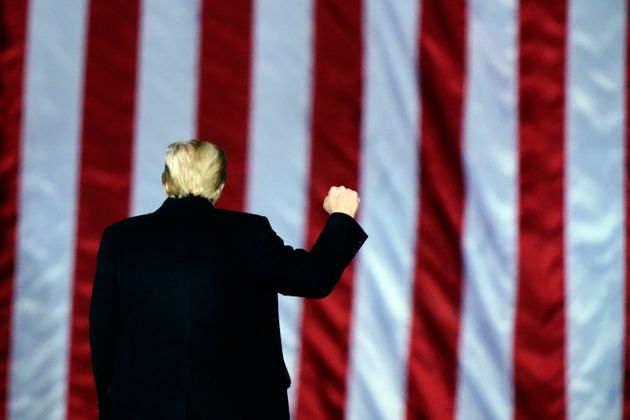 President Donald Trump gestures at a campaign rally in support of Senate candidates Sen. Kelly Loeffler,...