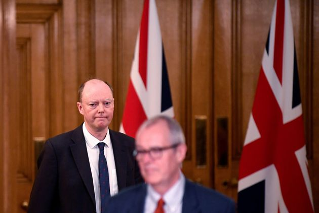 Chief Medical Officer for England Chris Whitty (L) and Chief Scientific Adviser Patrick Vallance arrive...