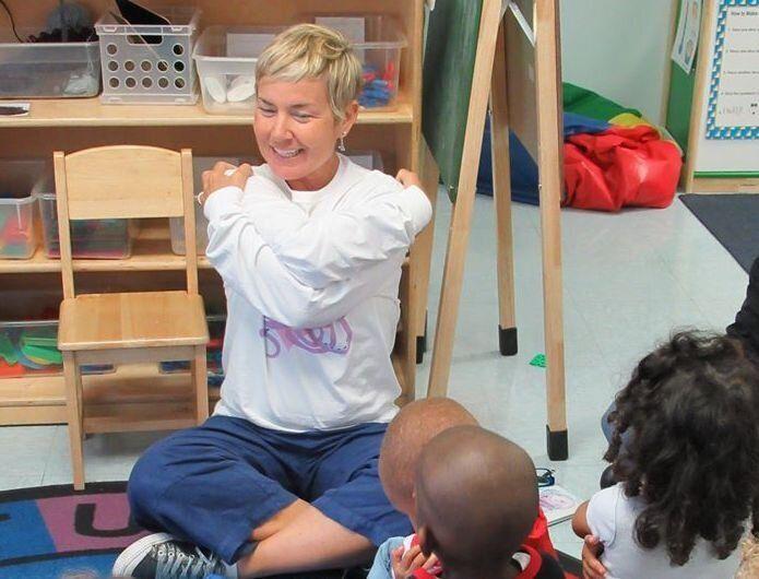 Sherry teaches children to self-hug.