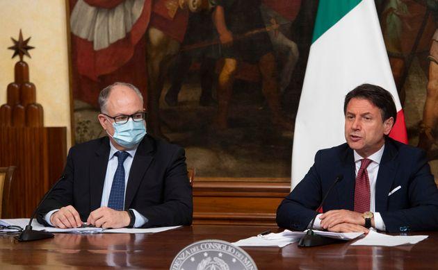 Italian Prime Minister, Giuseppe Conte, right, with Economy Minister Roberto Gualtieri, left, announces...