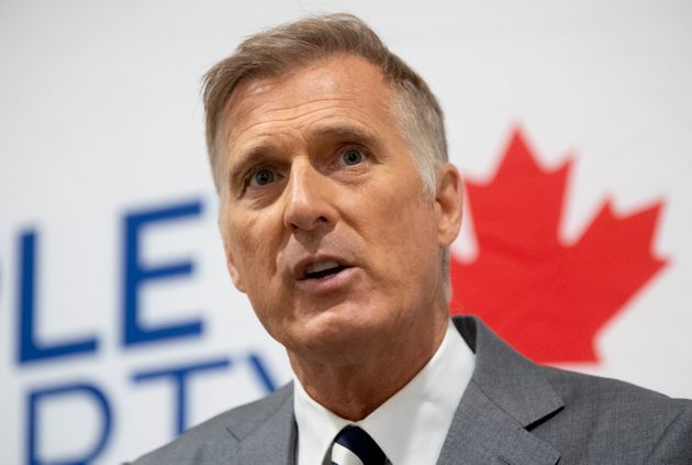People's Party of Canada Leader Maxime Bernier takes questions from the media during a news conference...