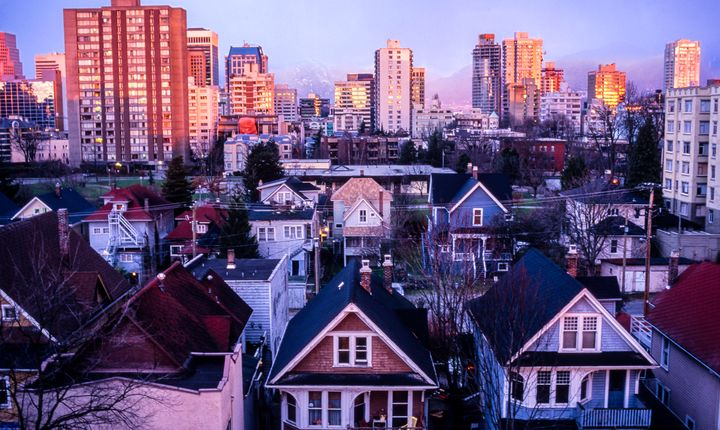 Houses and apartment buildings in Vancouver's West End. Canadians went on a December home-buying spree, new data shows.