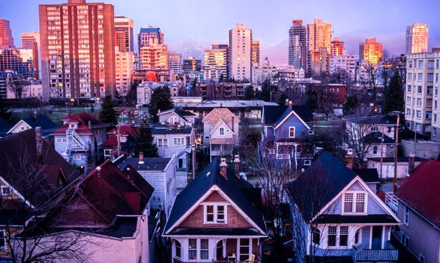 Houses and apartment buildings in Vancouver's West End. Canadians went on a December home-buying spree,...