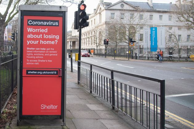 An advert on the side of a telephone box by homeless charity Shelter offering advise to anyone at risk...