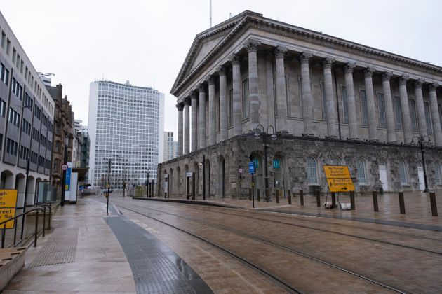 The lockdown begins in Birmingham, which was deserted outside the town hall on