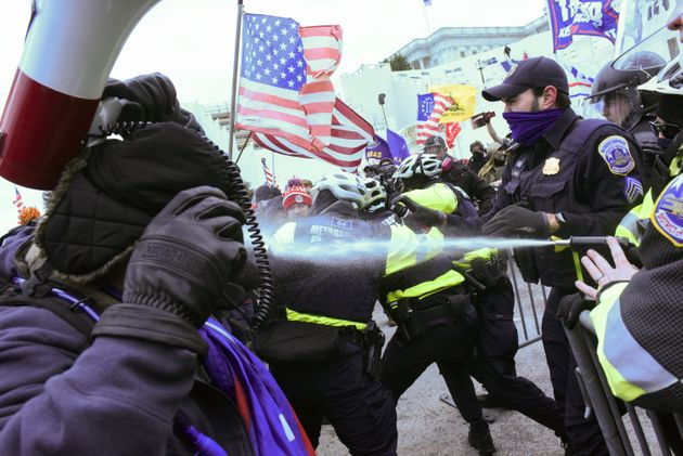 Supporters of Donald Trump clash with police officers in front of the US Capitol Building in