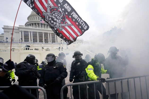 Police hold off Trump supporters who tried to break through a police barrier, Wednesday, Jan. 6, 2021,...