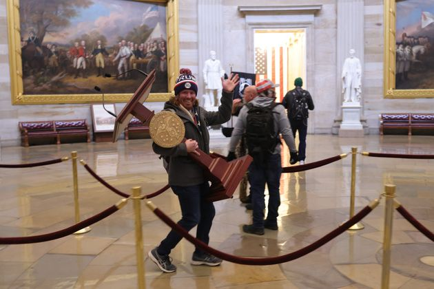Protesters looting the US Capitol Building after a group of Republican senators said they would reject...