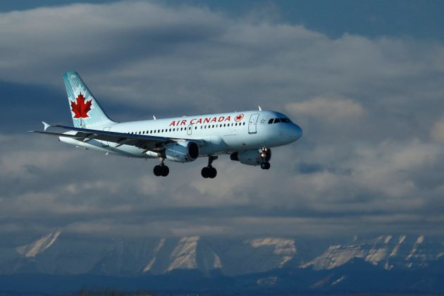 An Air Canada plane lands in Calgary, Alberta on Nov. 28,