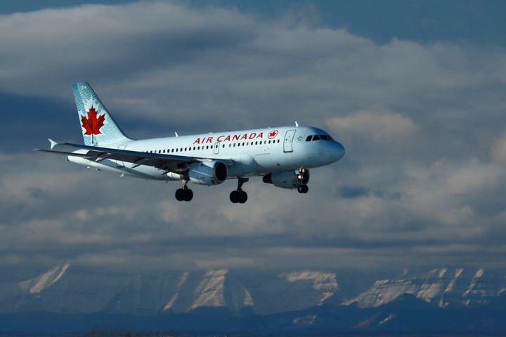 An Air Canada plane lands in Calgary, Alberta on Nov. 28, 2020.