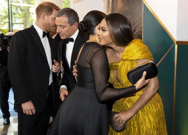"""Meghan Markle greets Beyoncé as Prince Harry chats with Disney CEO Bob Iger at the London premiere of """"The Lion King"""" on July 14, 2019."""