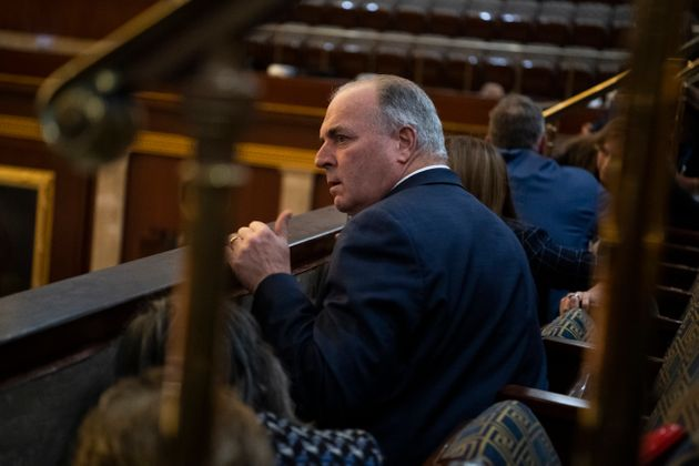 Rep. Dan Kildee, D-Mich., and other members take cover as rioters attempt to break into the House chamber...