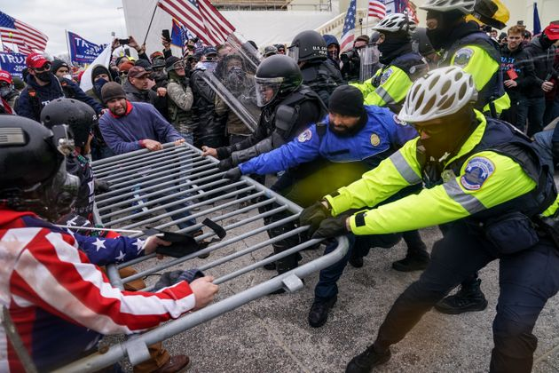 Trump supporters try to break through a police barrier, Wednesday, Jan. 6, 2021, at the Capitol in