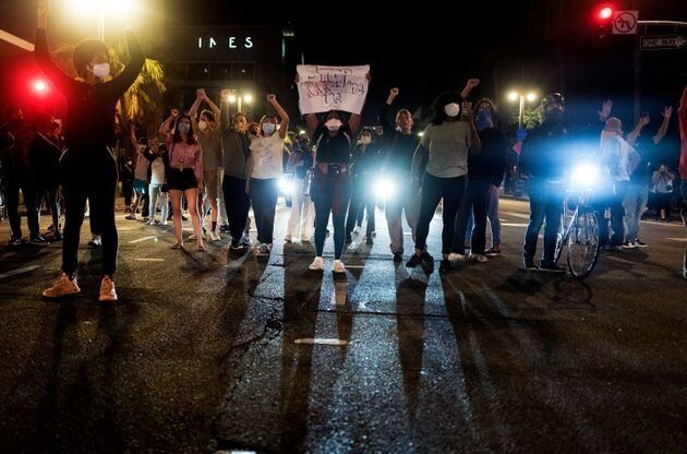 Demonstrators block traffic during a protest in Los Angeles in May 2020 over the death of George Floyd...